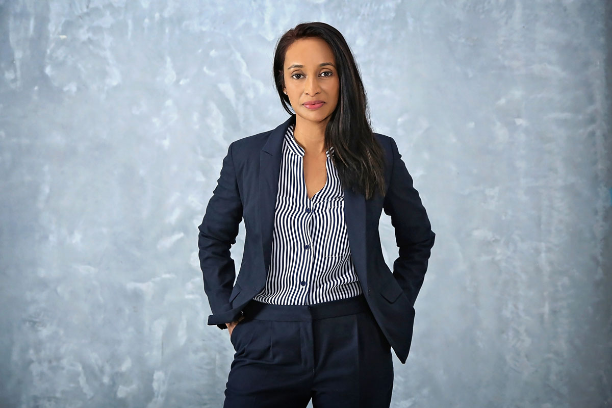 portrait of a businesswoman smiling with hands on hips