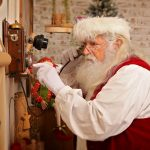 Santa making a call on a vintage phone