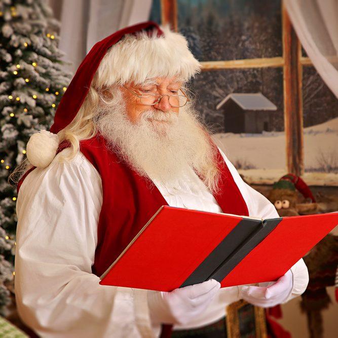 Santa reading a red book